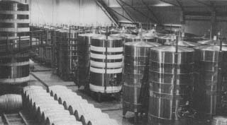Wine is processed in a modern distillery.