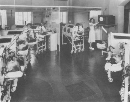Patients being treated in iron lungs. Today, the iron lung of the 1950s is making a comeback. Because it uses non-invasive technology and negative air pressure, it does not cause infections or scarring of the trachea.