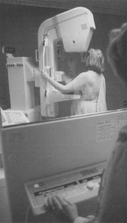 A woman undergoes mammography screening. For women under forty, the procedure is recommended only for those at risk of developing the disease because ofa family history of breast cancer or other high-risk factors.