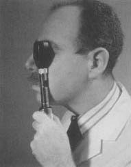 A modern ophthalmoscope in use.