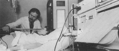 As this woman's labor progresses, an electronic sensor is attached to her abdomen to monitor uterine contractions and the fetal heartbeat.