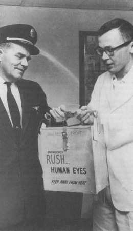 A Trans World Airlines pilot delivers an eye from a San Diego eye bank to a doctor at the Kansas City Medical Center. The cornea of the eye was later transplanted into the eye of a patient at the center.